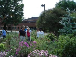 Extension Agent Kirsten Buhls and a group of visitors at the Simpson Gardens Open House on September 28.