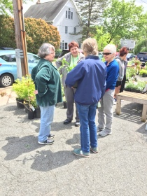 Garden coordinator Alyssa Ford Morel offers assistance with plant selections