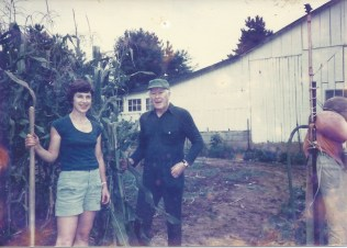 Judy and John, mentor and friend, standing in front of a barn