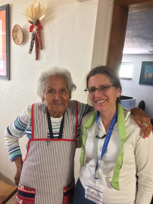 Wendy Mills with 81-year old Maria Romero, award winning, Cochiti potter known for her story teller figures