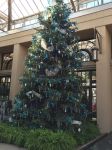 Huge decorated tree carries through the color theme in the East Conservatory.