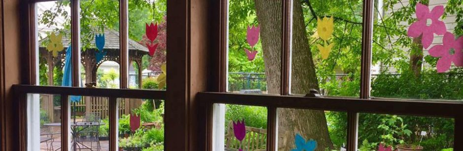 View of Glencarlyn Library Community Garden through the library window.