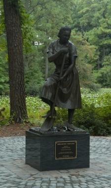 """""""Breaking Ground,"""" a sculpture honoring workers in the WPA Memorial Garden. Norfolk Botanical Garden."""